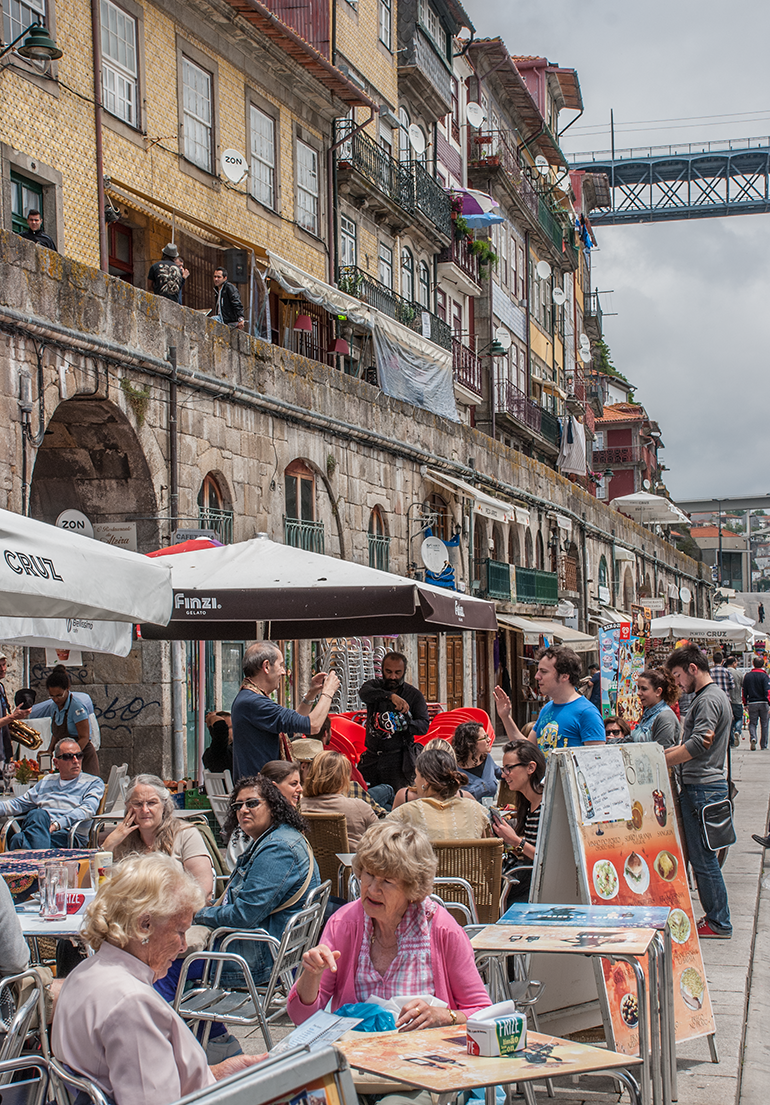 The bars and restaurants of the Praça da Ribeira waterfront shelter under medieval arches