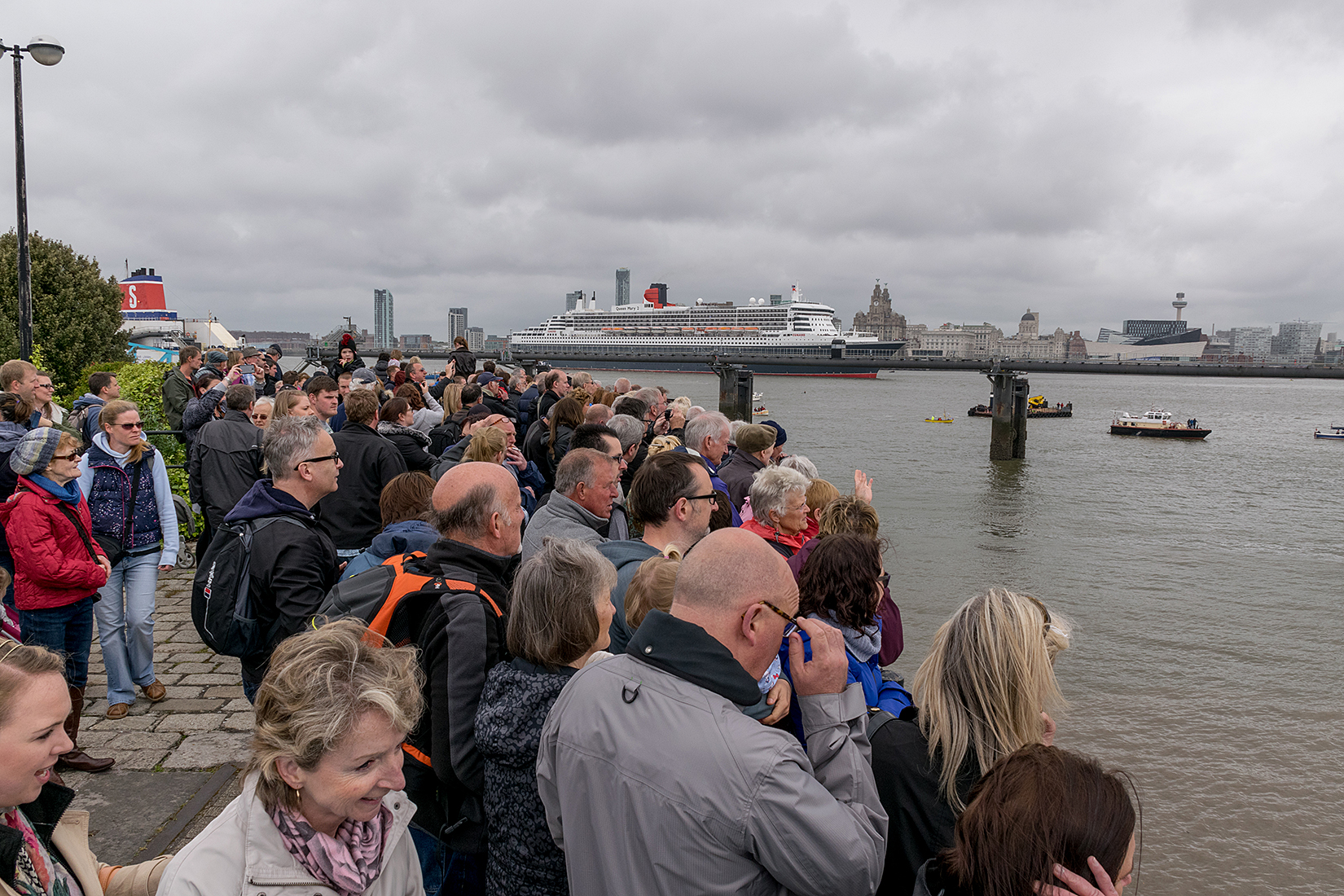 Hundreds of thousands of spectators lined the Mersey to watch the Three Queens make maritime history