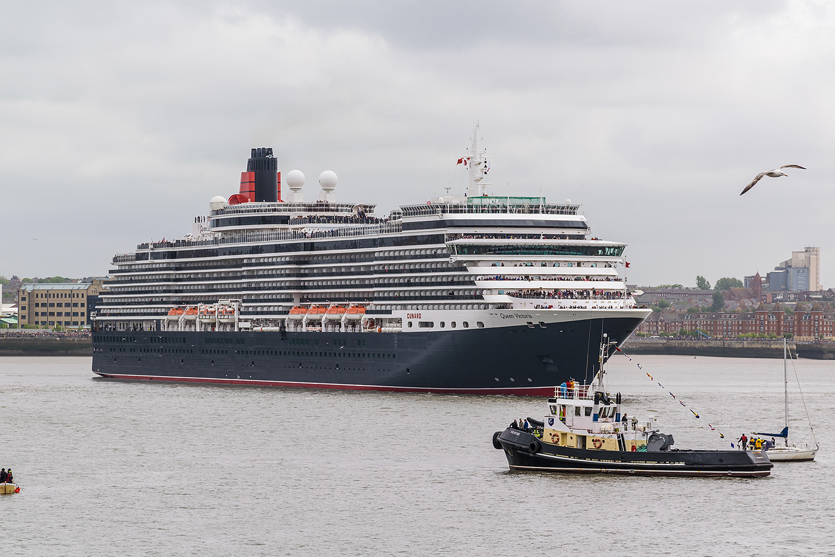 Queen Victoria starts her manouver opposite the Liverpool Echo Arena