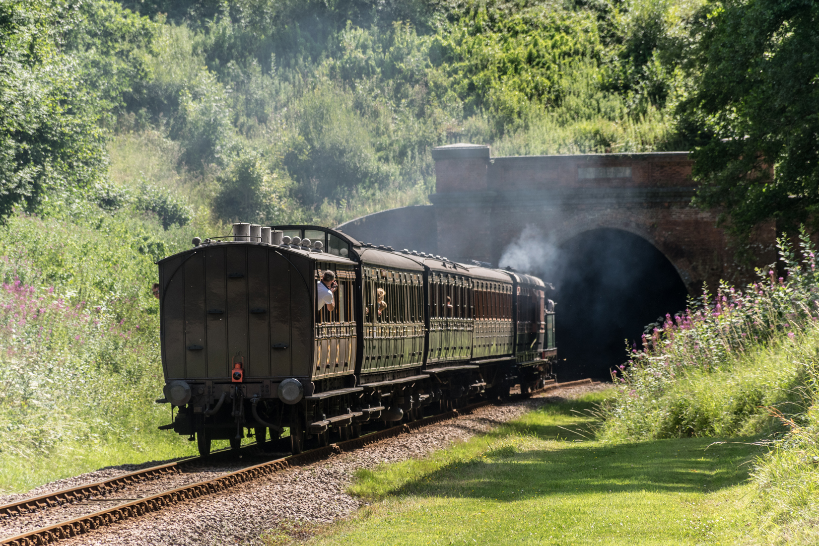 SECR No.263 with its rake of preserved coaches entering West Hoathly tunnel
