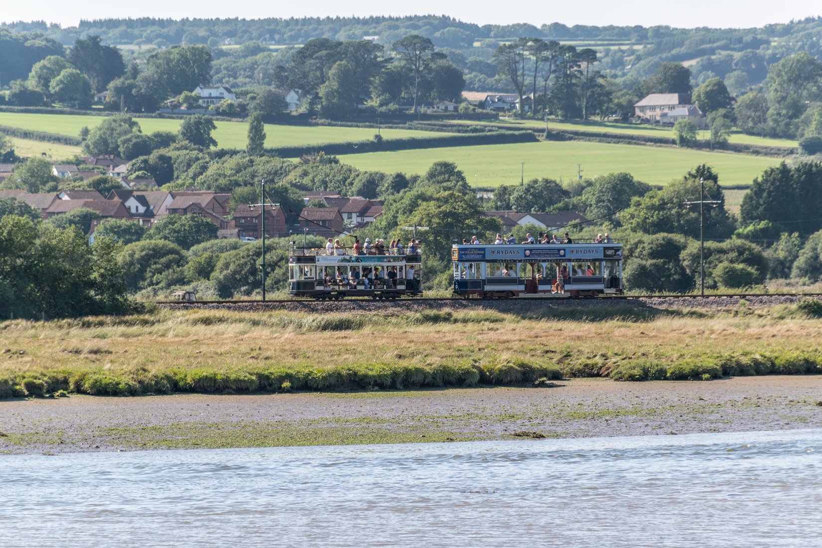 Cars 8 and 9 at Axmouth passing loop - viewed from Axmouth village across the River Axe
