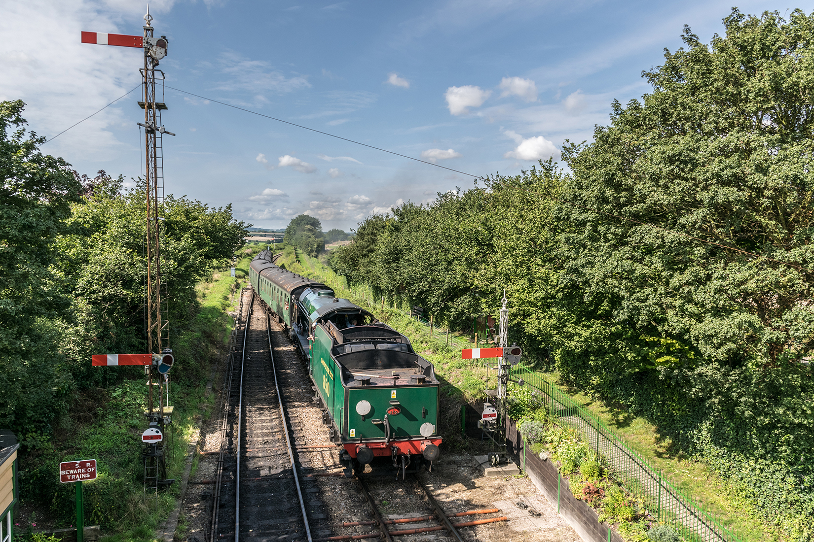 850 'Lord Nelson' pulling into Ropley station with an Alton bound train from Alresford