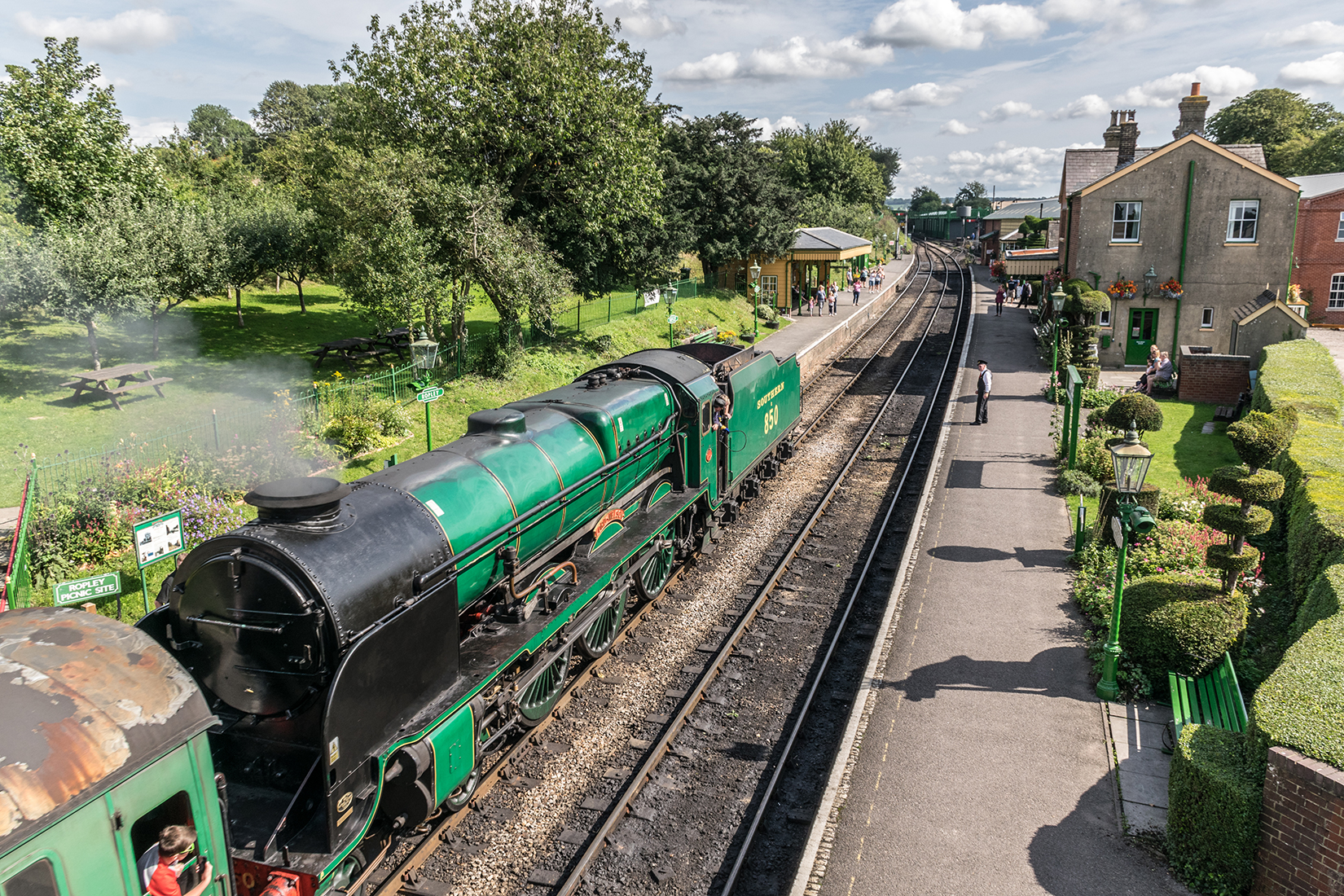 850 'Lord Nelson' at Ropley station with an Alton bound train from Alresford