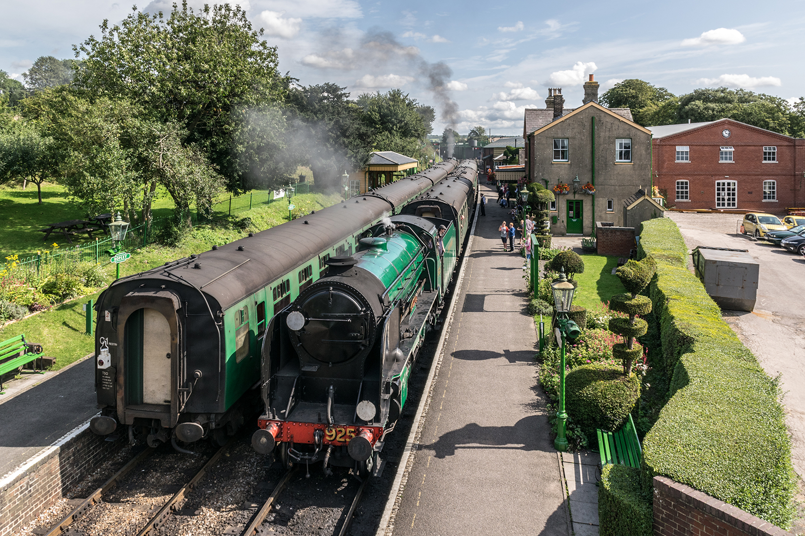 Schools' class 4-4-0, 925 'Cheltenham', pulls into Ropley station with an Alresford bound service from Alton