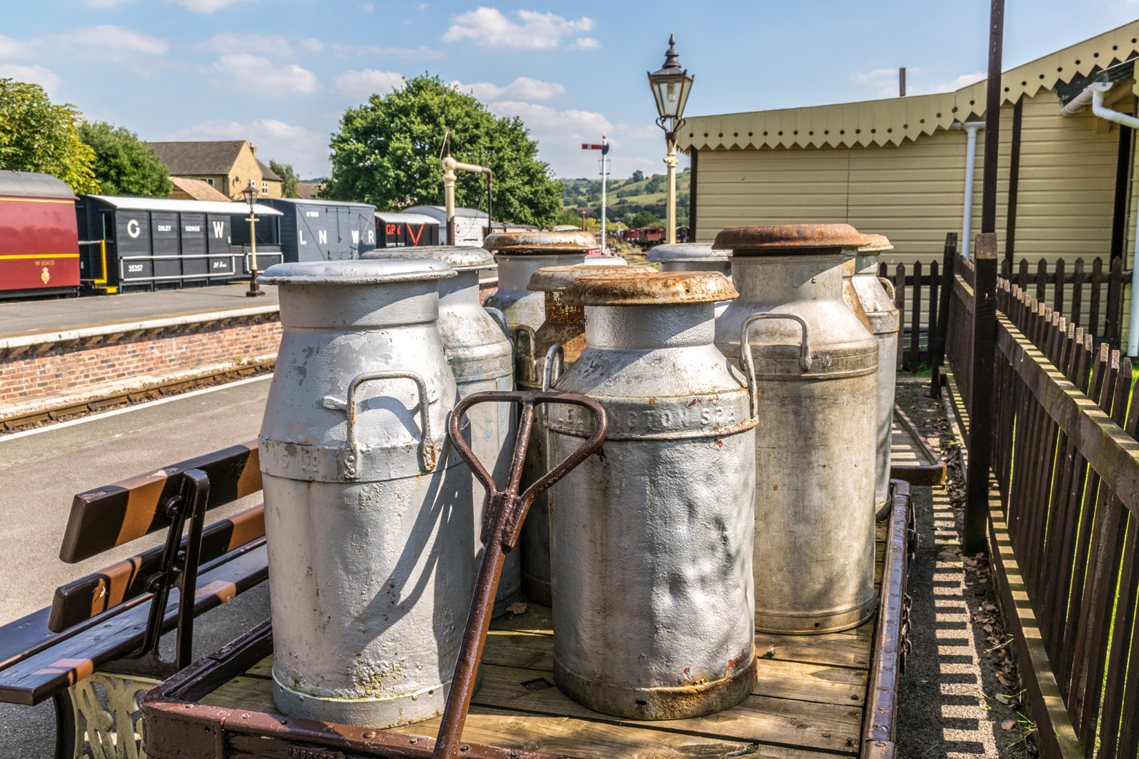 Restored milk churns on display at Winchcombe
