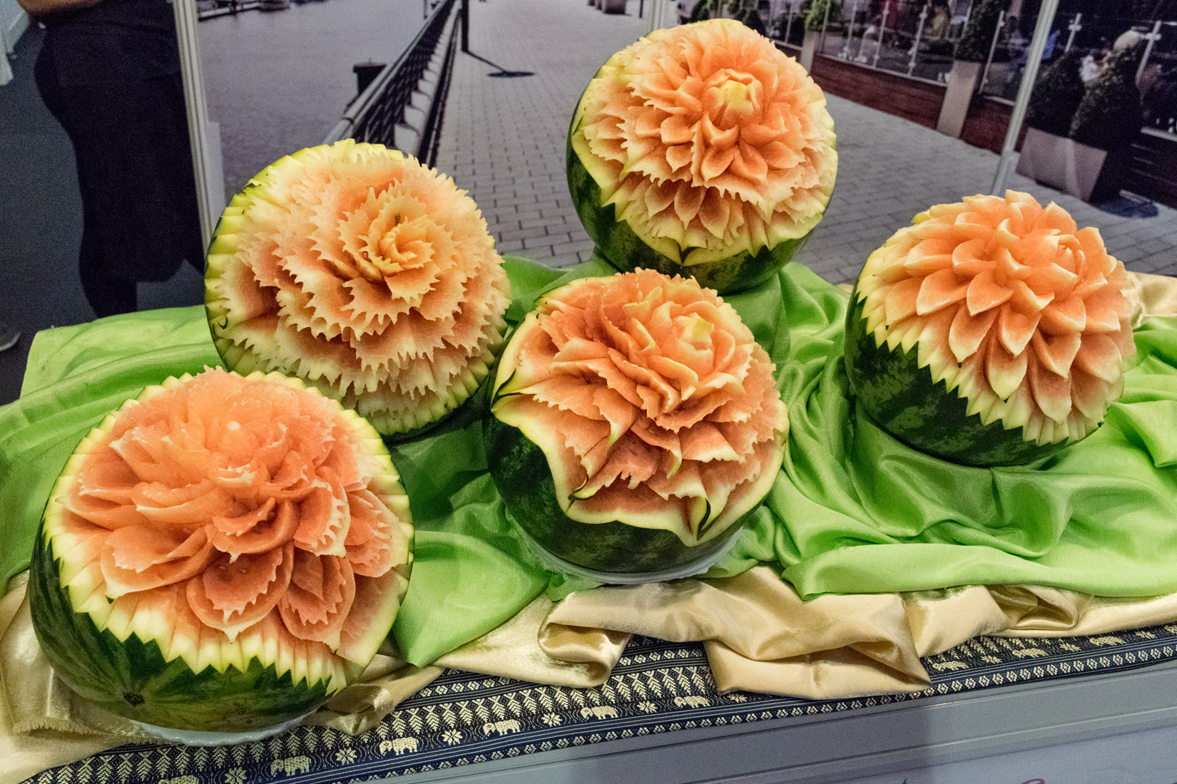 Carved watermelons against a backdrop photograph at the Blue Elephant pop-up Thai restaurant