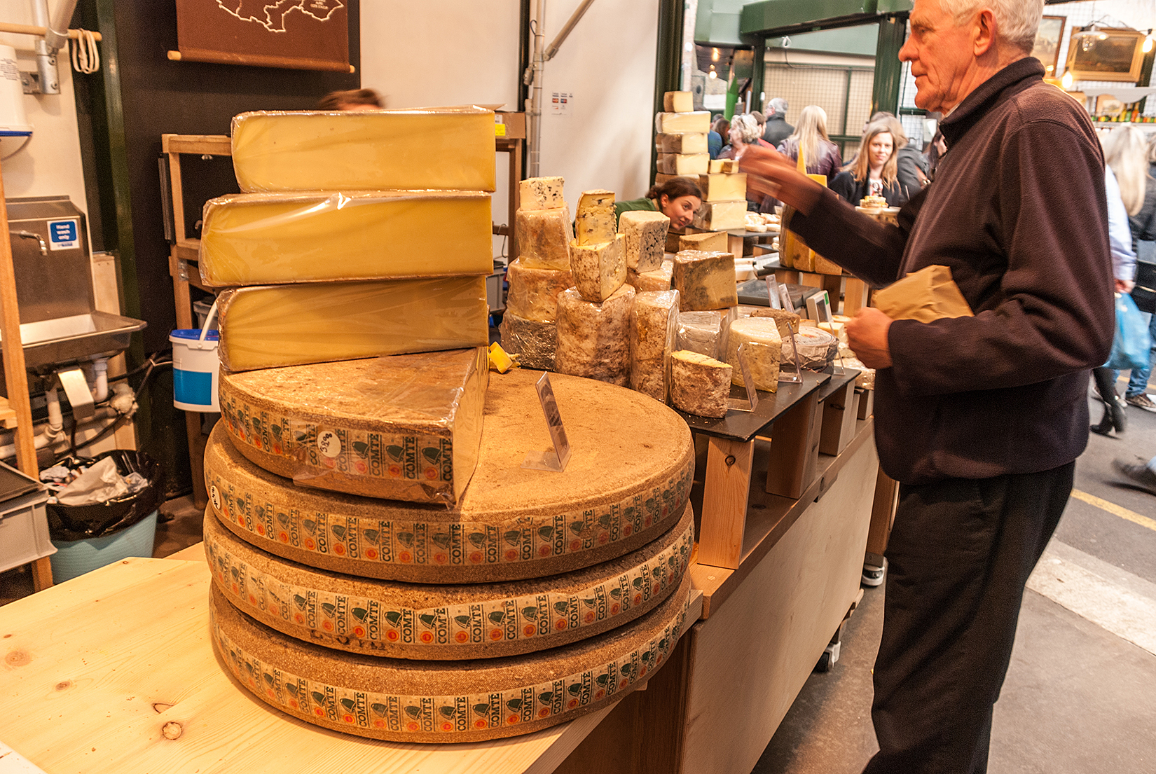 Spectacular wheels of Comté cheese produced in the Jura Massif region and matured in the 19th century Fort Saint Antoine