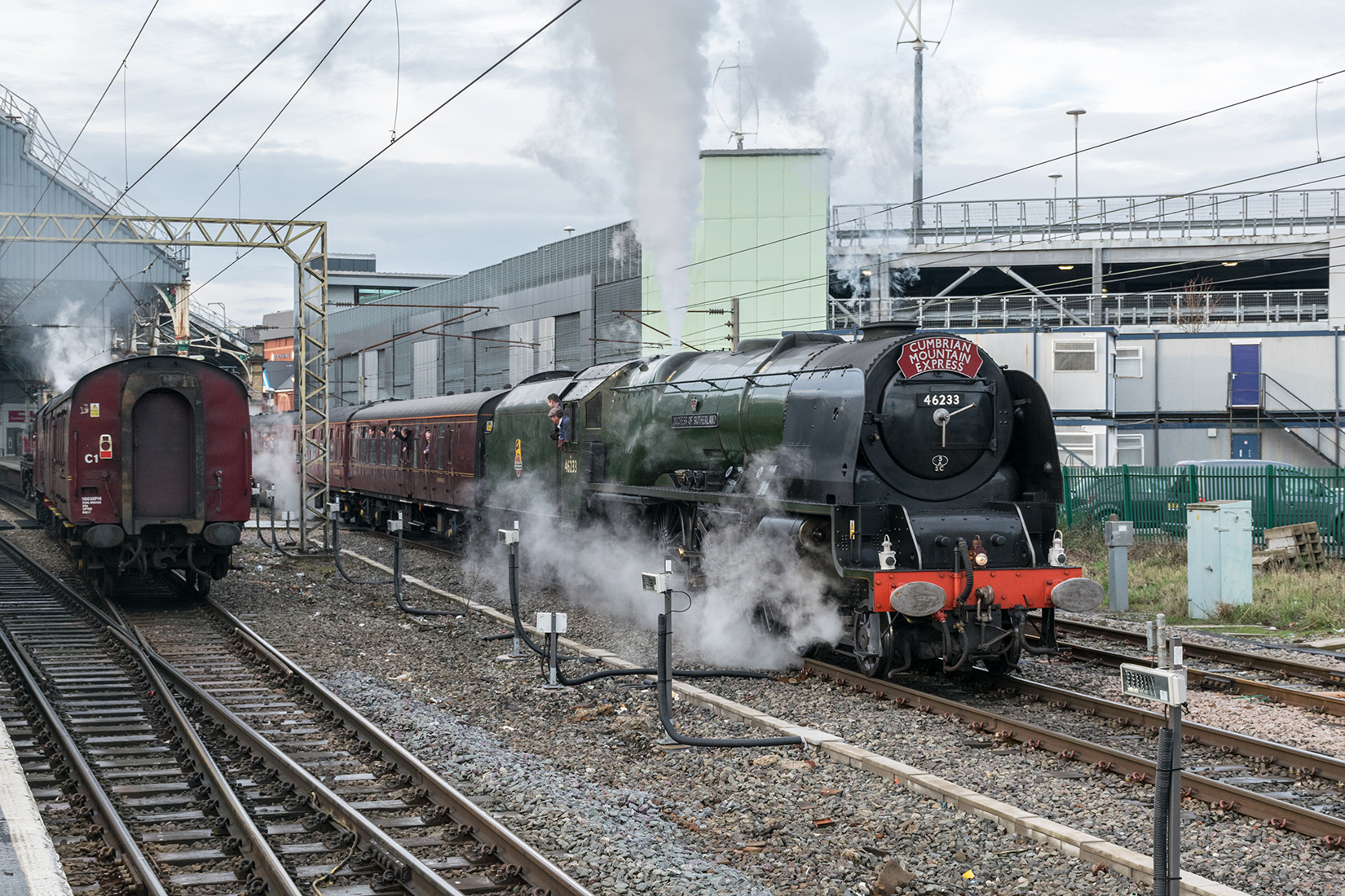 'Duchess of Sutherland' at Preston station is passed by Jubilee 'Galatea'