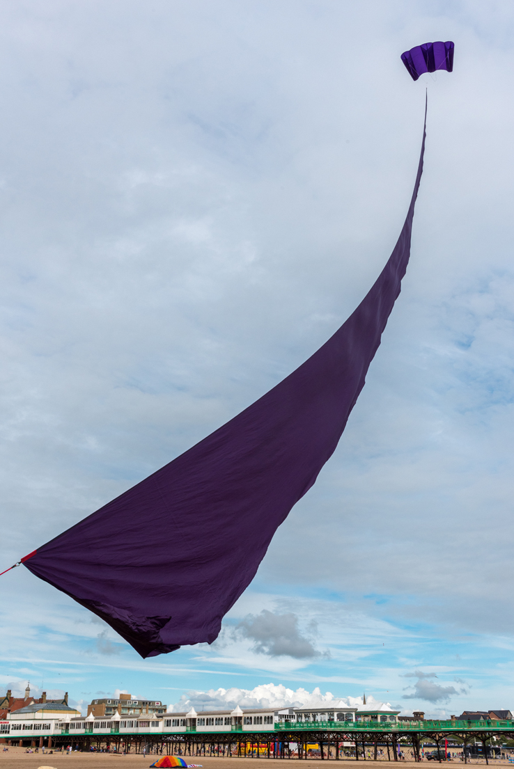 Simple grace and beauty with a single kite-drawn sail.