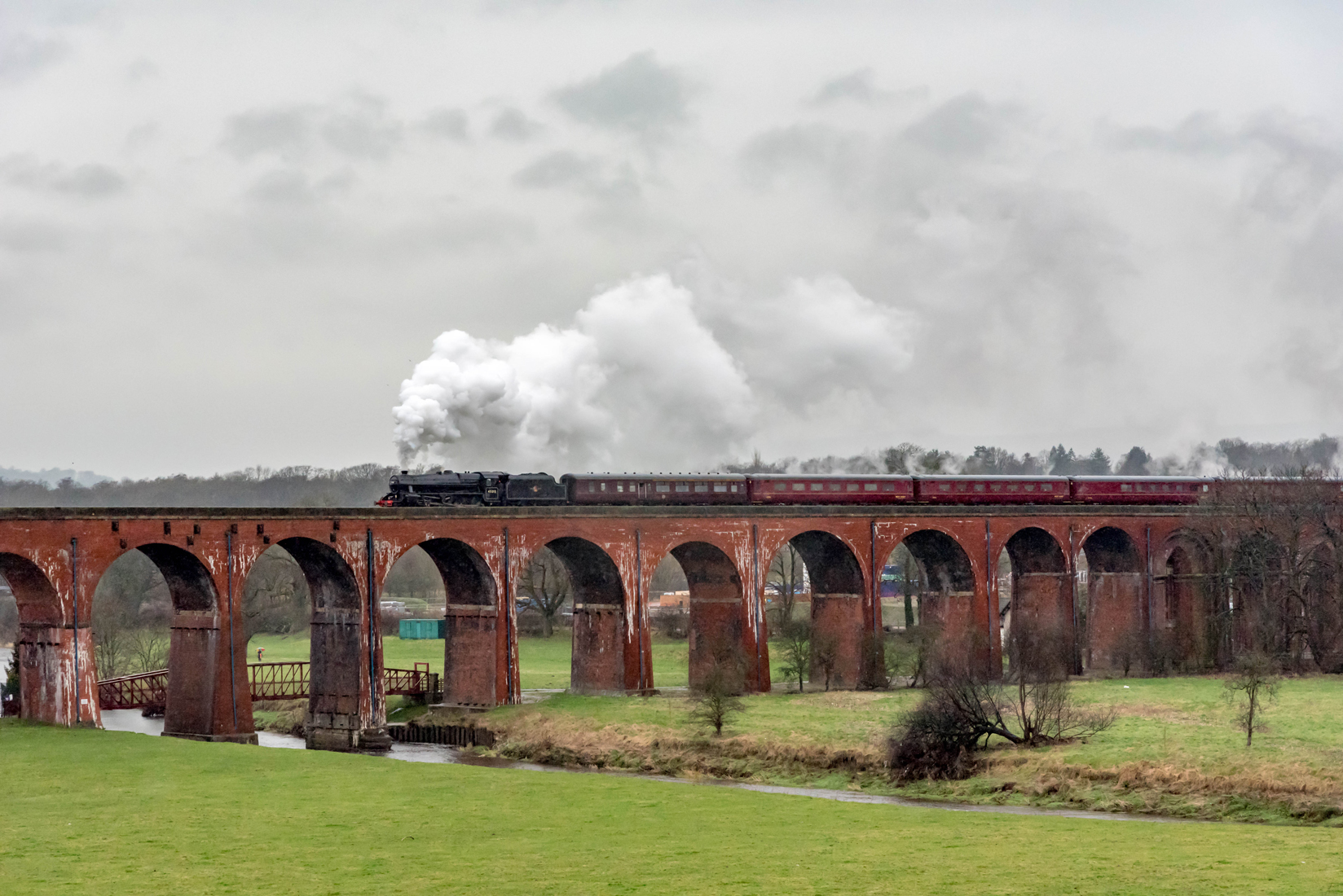 45212 crossing the River Calder on Whalley Viaduct.