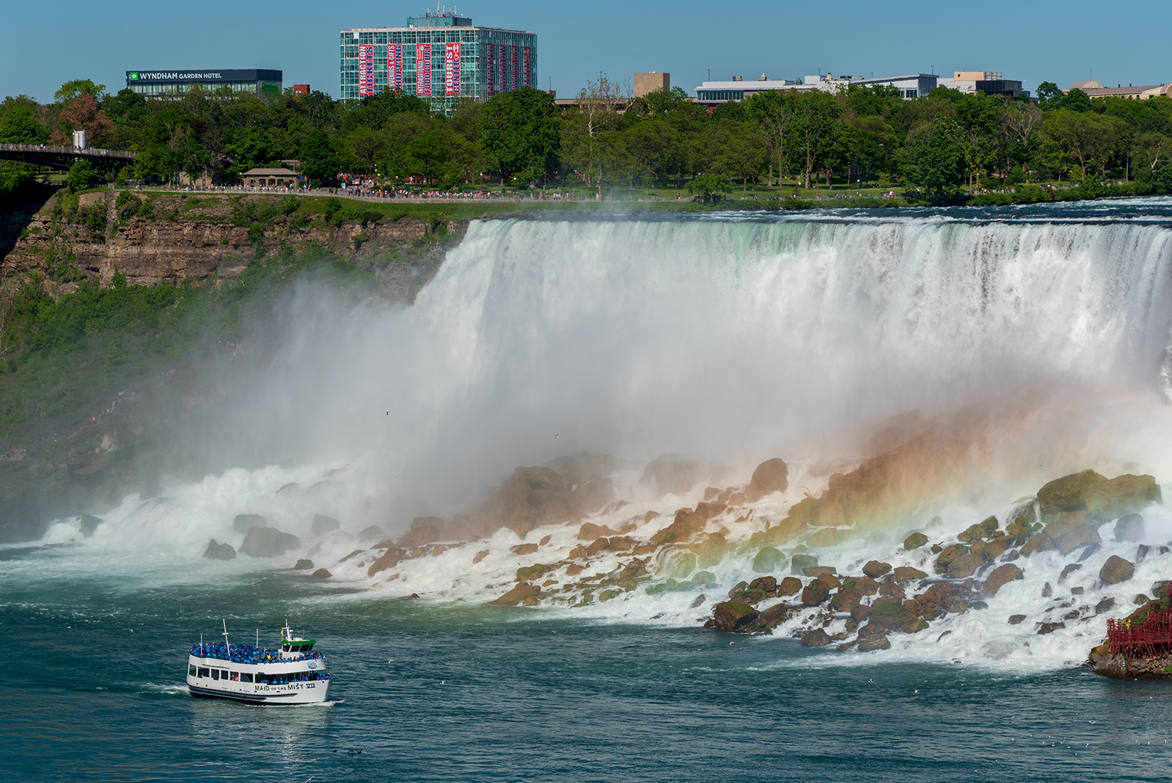 'Maid of the Mist' cruise boat passing the American Falls